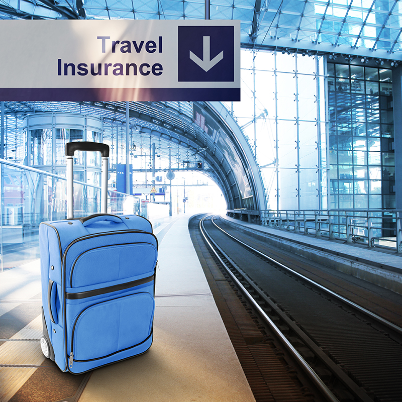 Suitcase at a train station with Travel Insurance sign